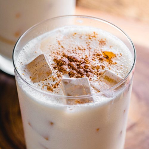 Pumpkin spice bourbon milk punch cocktail featured image.