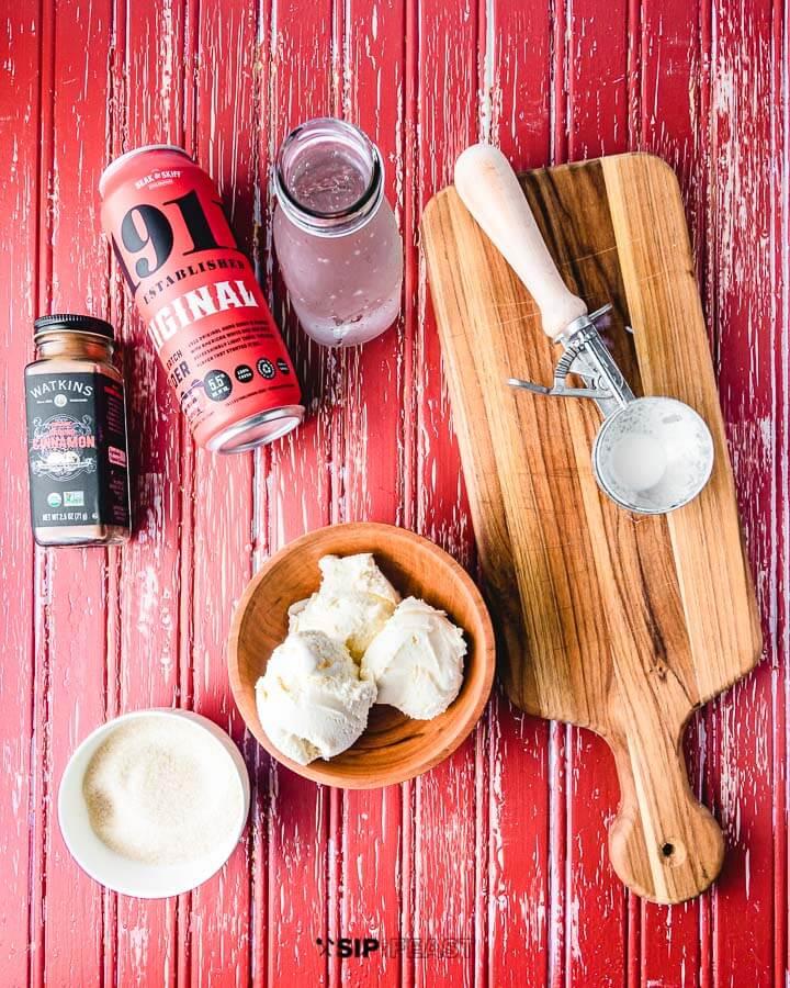 Ingredients shown: hard apple cider, ice cream, cinnamon, seltzer, and sugar.
