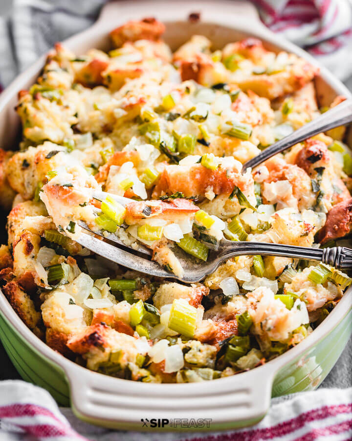Green baking dish with cooked stuffing.