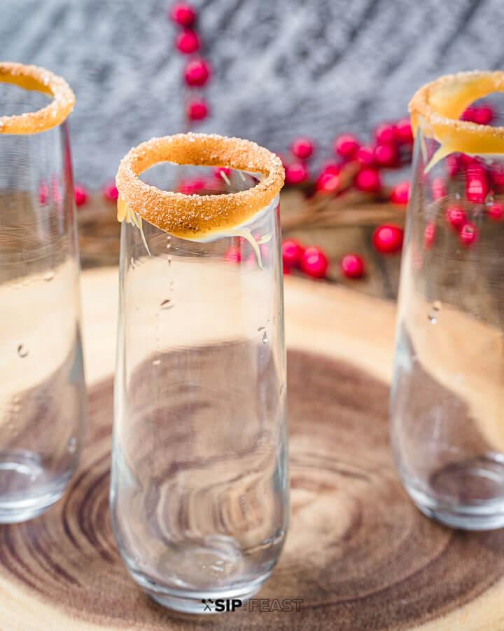 Empty champagne glasses with caramel, sugar and cinnamon rims.