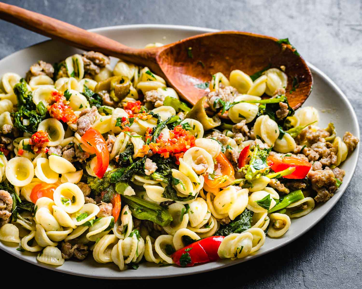 Platter of orecchiette, sausage, broccoli rabe, and cherry peppers.