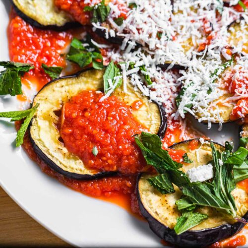 Roasted eggplant with sauce, mint, and ricotta salata featured image.