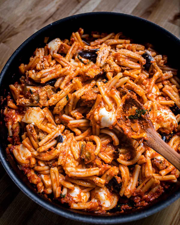 Casarecce pasta with eggplant and mozzarella in large pan.