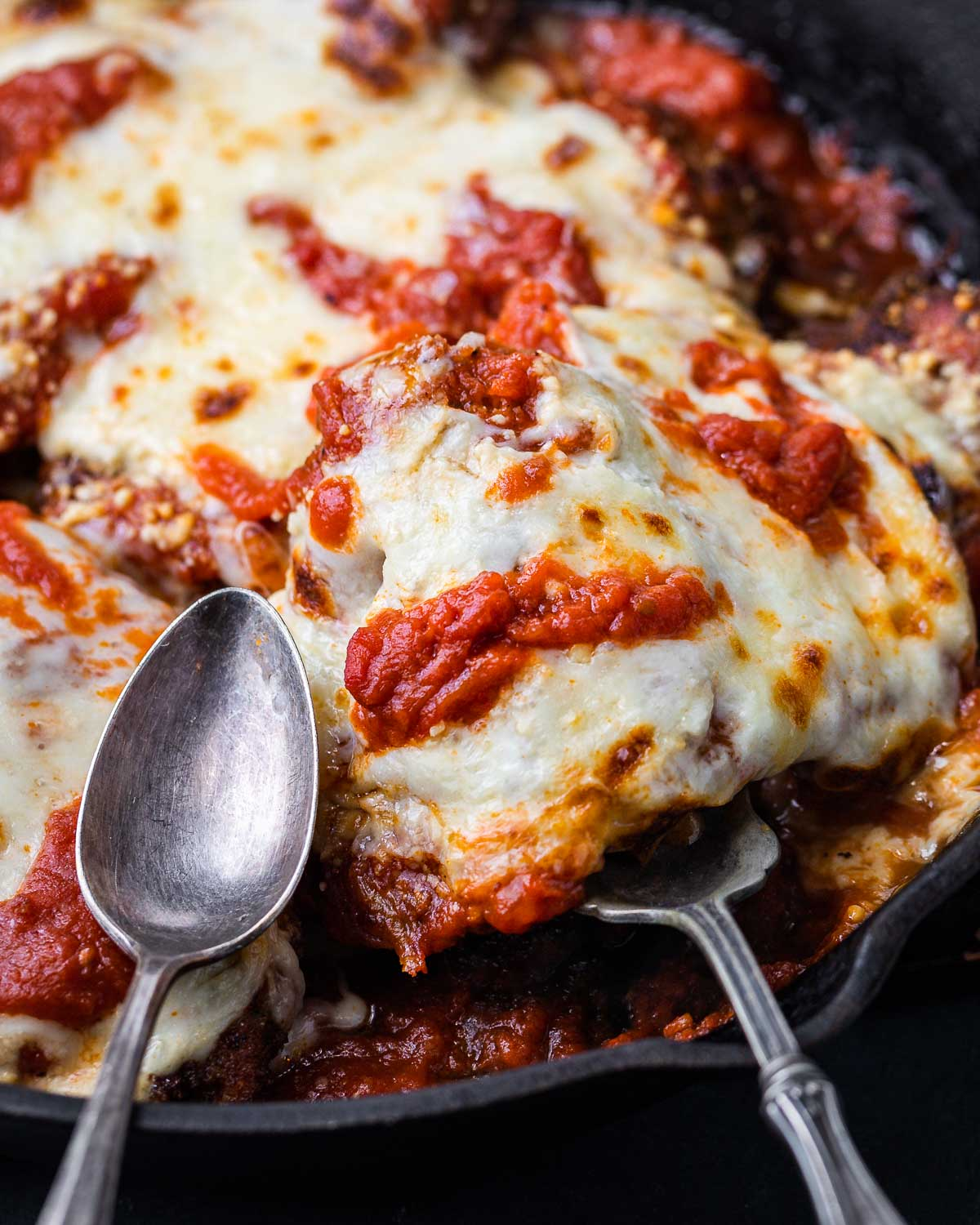 Chicken parmigiana scooped out of pan.
