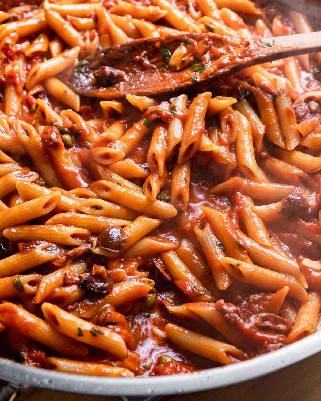 Large pan of pasta puttanesca.