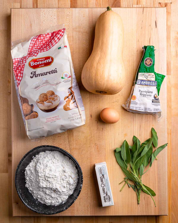 Ingredients shown: Amaretti cookie bag, butternut squash, Parmigiano Reggiano, egg, flour, butter, and sage.