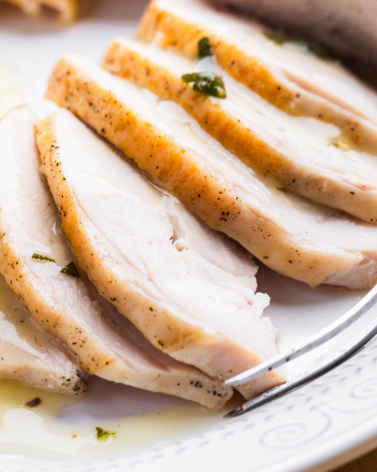Close up shot of sliced turkey breast pieces.