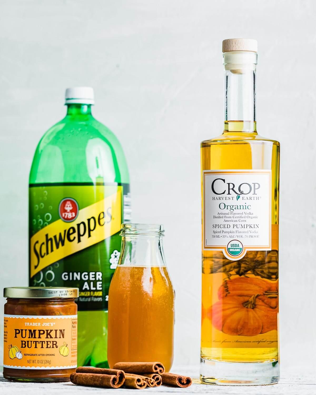 Ingredients shown: Ginger ale, apple cider, cinnamon sticks, and pumpkin butter.