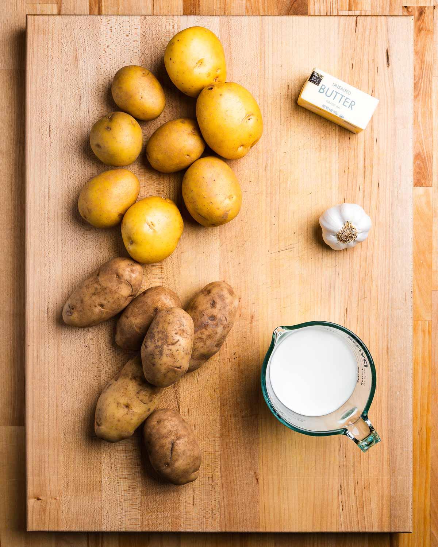 Ingredients shown: Yukon Gold potatoes, butter, garlic, milk, and russet potatoes.