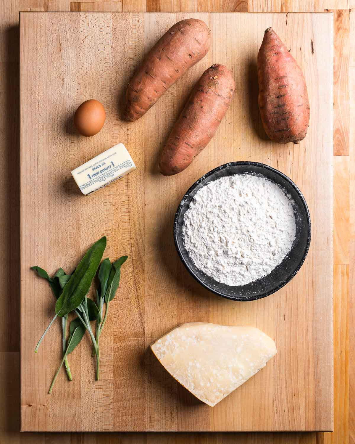 Ingredients shown: sweet potatoes, egg, butter, flour, sage, and parmesan cheese.